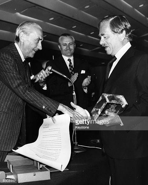 On a day when the EMI Group won two Queen's Awards to Industry for exports FieldMarshal Sir Gerald Templer KG presents one for export achievement to...