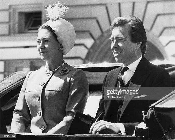 Princess Margaret and her husband Antony ArmstrongJones the Earl of Snowdon attend the Trooping the Colour ceremony at Buckingham Palace London