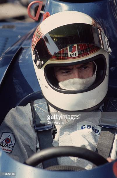 Racing driver Jackie Stewart in the cockpit of a Tyrell Ford racing car at Monte Carlo