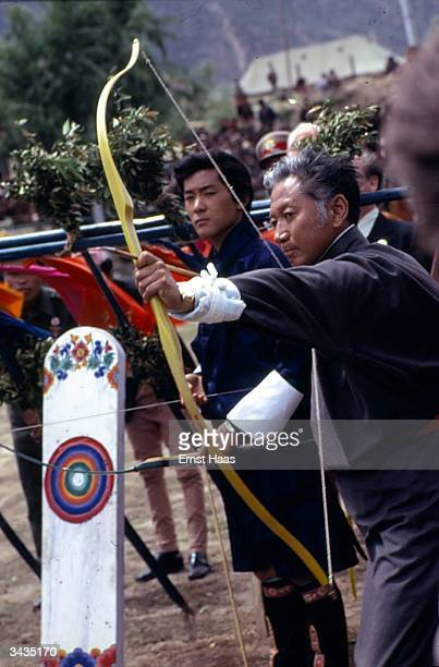 His Majesty Jigme Singye Wangchuk in an archery contest with His Highness Palden Thondup Namgyal the Chogyal of Sikkim Himalayan pilgrimage book