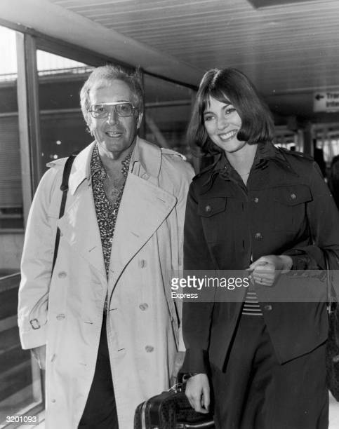 British actor and comedian Peter Sellers and his fiance British actor Lynne Frederick arrive at Heathrow Airport London England