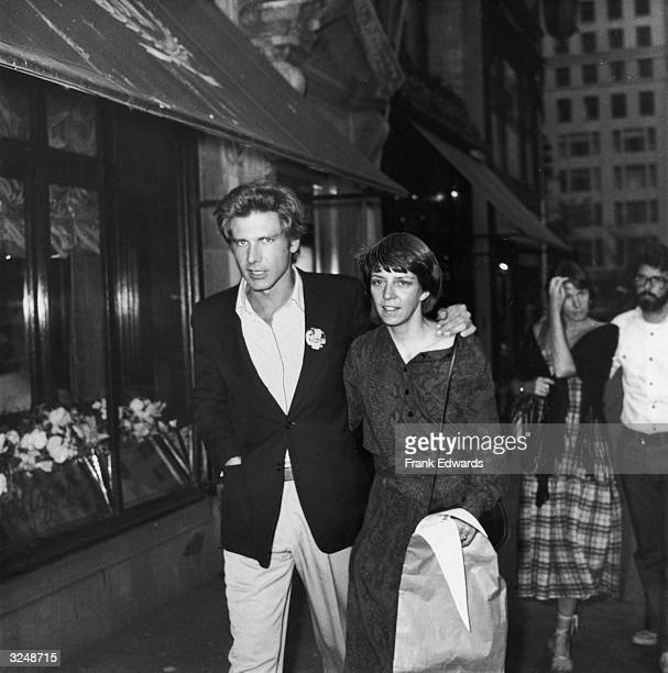 American actor Harrison Ford and wife Mary Marquardt walking in New York City Filmmaker George Lucas and wife Marcia walk behind them
