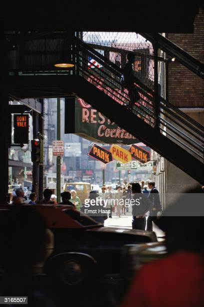 Crowds in a New York Street seen from under an elevated railway