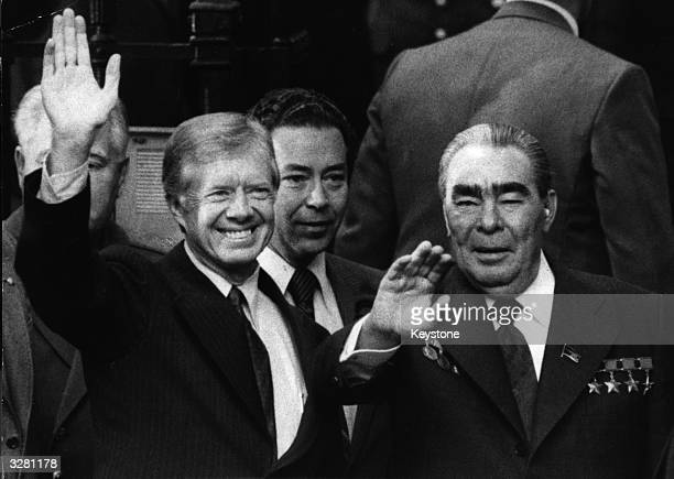 American statesman Jimmy Carter the 39th President of the United States and the Soviet leader Leonid Brezhnev wave after signing the Strategic Arms...