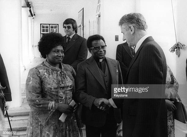 The exprime minister Ian Smith congratulating the new Prime Minister of Zimbabwe Abel Muzorewa and his wife