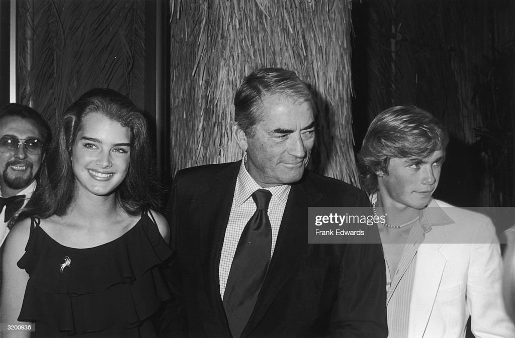 American actors (L-R) Brooke Shields, Gregory Peck (1916 - 2003) and Christopher Atkins at the Hollywood premiere of director Randal Kleiser's film 'The Blue Lagoon,' Hollywood, California. Shields and Atkins costarred in the film.