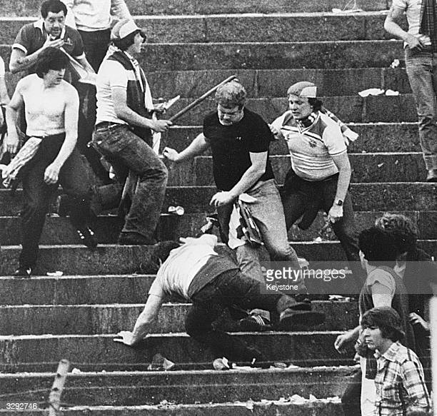 British football fans riot during a World Cup football match in Basle in which Switzerland defeated England by two goals to one