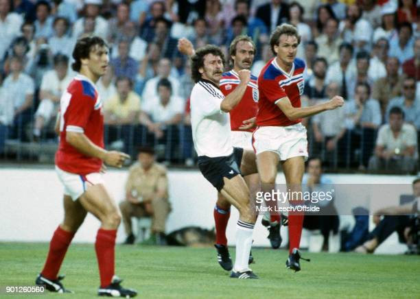FIFA World Cup England v West Germany Paul Breitner of Germany shoots as he is challenged by Mick Mills and Phil Thompson