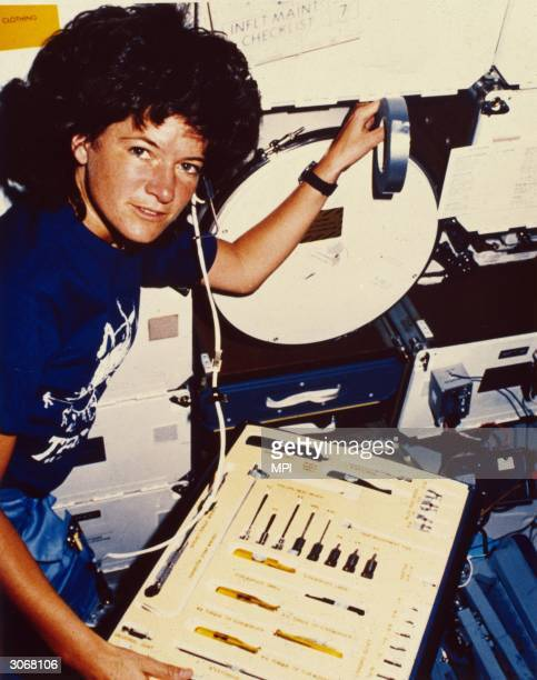 Astronaut Sally Kirsten Ride the first American woman in space inspects the array of tools at her disposal during her earth orbit in the Challenger...