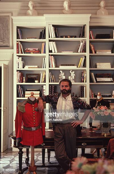 Dress designer Gianni Versace with a dress dummy wearing military uniform in his home on Lake Como