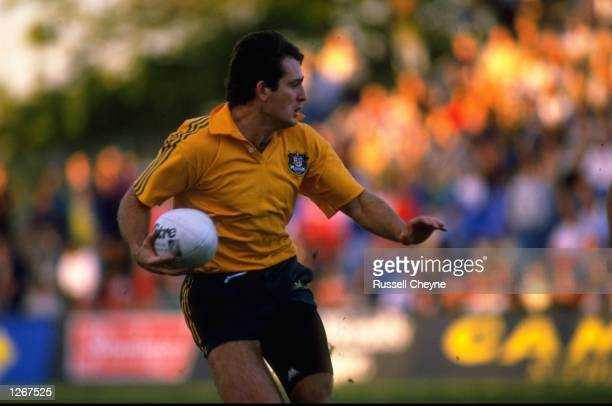 David Campese of Australia looks around for support as he drives forwards with the ball during the World Cup SemiFinal match against France in Sydney...