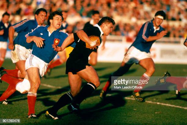 Rugby Union Test Match New Zealand v France Michael Jones of the All Blacks escapes the clutches of Franck Mesnel