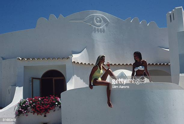 Victoria and Francesca Pereira sunning themselves on a balcony in the Algarve Portugal