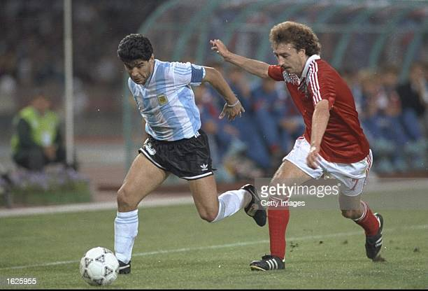 Diego Maradona Of Argentina takes on Sergey Aleinikov of the USSR during the Argentina versus USSR match at the 1990 World Cup in Naples Italy...