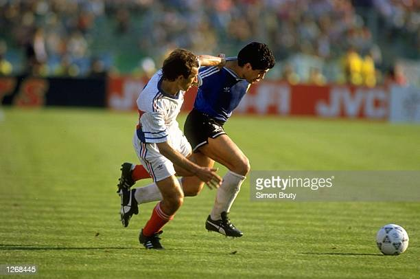 Dragoljub Brnovic of Yugoslavia tackles Diego Maradonna of Argentina during the World Cup Quarter Final match in the Comunale Stadium in Florence...