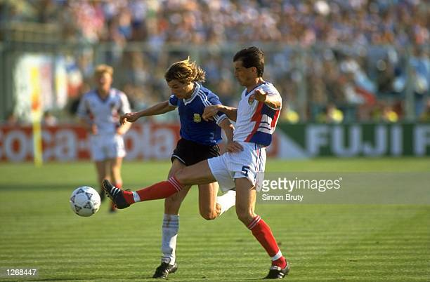 Faruk Hadzibegic of Yugoslavia tries to get to the ball in front of Claudio Caniggin of Argentina during the World Cup Quarter Final match in the...
