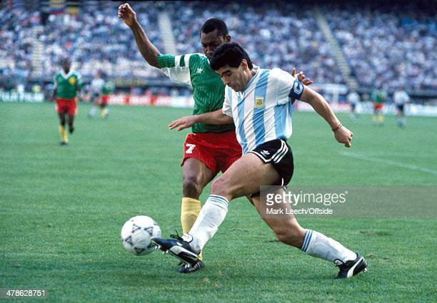 08 June 1990 FIFA World Cup Argentina v Cameroon Diego Maradona of Argentina dribbles with the ball challenged by Francois OMAMBIYIK of Cameroon