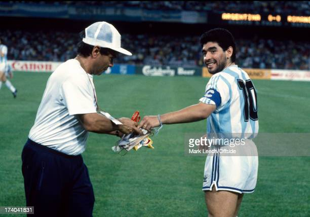 18 June 1990 Fifa World Cup Argentina v Romania Argentinean captain Diego Maradona has to have a pennant cut from his wrist after it was entangled...