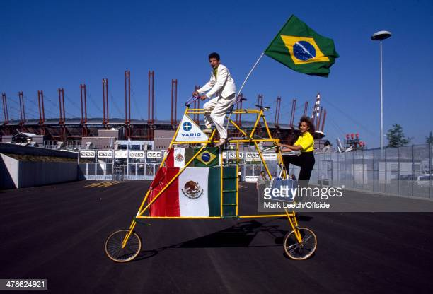 10 June 1990 FIFA World Cup Brazil v Sweden A strange bicycle with Mexican and Brazilian flags is paraded outside the Juventus Stadium