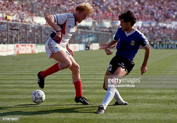 June 1990 - Fifa World Cup Quarter Final - Yugoslavia v Argentina - Robert Prosinecki of Yugoslavia tries to dribble past Juan Simon of Argentina.