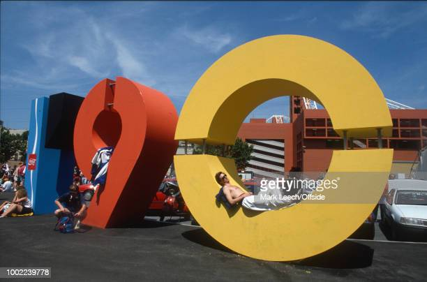 11 June 1990 Genoa FIFA World Cup a fan sunbathes lying in the zero of the Italia '90 logo