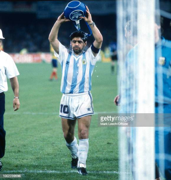 June 1990 - Naples - FIFA World Cup - Argentina v Romania - Diego Maradona of Argentina tips a bottle of water over his head to cool down -