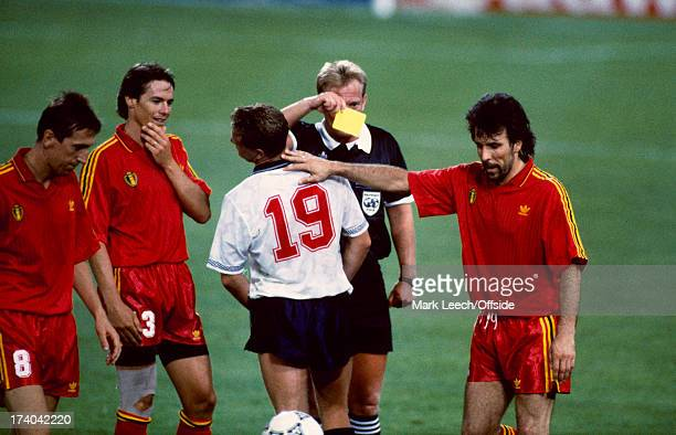 26 June 1990 World Cup round of 16 England v Belgium Referee Peter Mikkelsen shows the yellow card to Paul Gascoigne who receives a sympathetic arm...