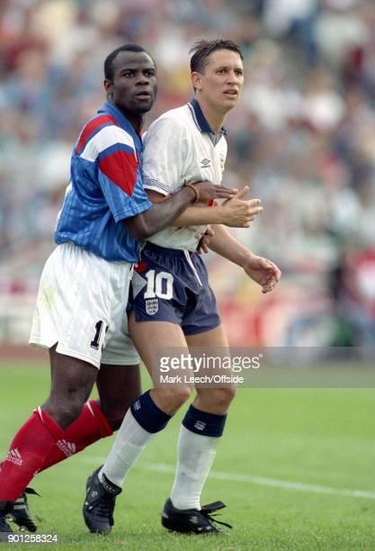UEFA European Football Championships France v England Basile Boli of France holds tightly to Gary Lineker
