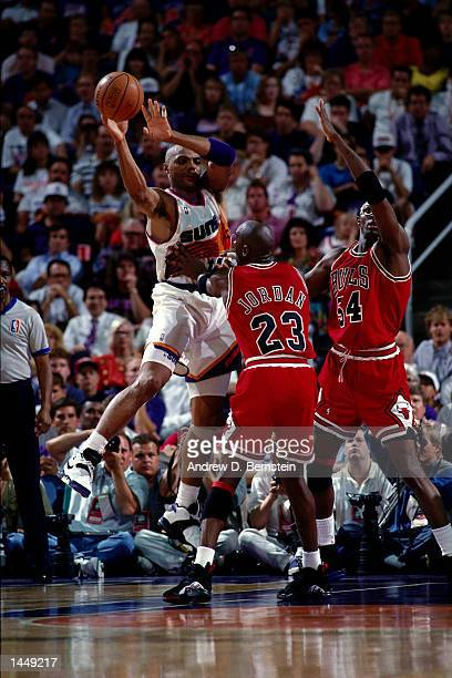 Charles Barkley of the Phoenix Suns passes against Michael Jordan of the Chicago Bulls during the 1993 NBA Finals in Phoenix AZ HIGH RESOLUTION 70Mb...