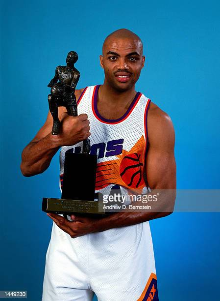 Charles Barkley of the Phoenix Suns poses for a portrait with his 199293 Most Valuable Player trophy during the 1993 NBA Finals in Phoenix Arizona...