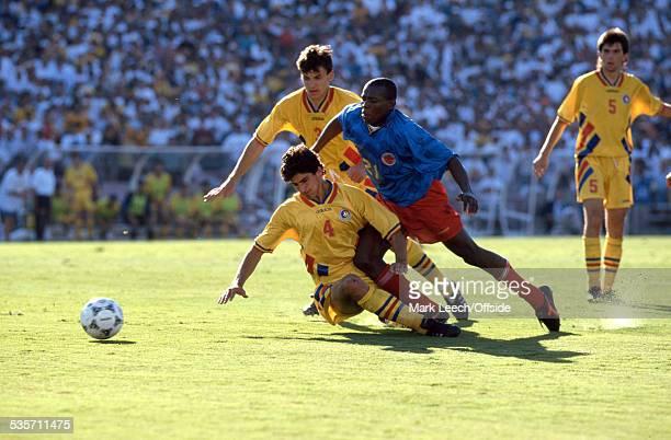 18 June 1994 Fifa World Cup Colombia v Romania Miodrag Belodedici of Romania tackles Faustino Asprilla of Colombia