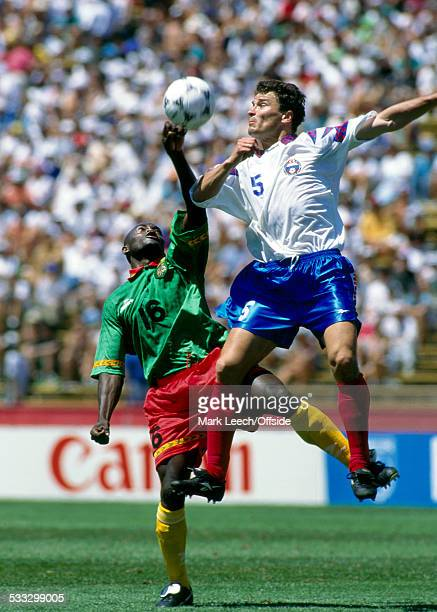 28 June 1994 Fifa World Cup Russia v Cameroon AlphonseMarie Tchami of Cameroon is outjumped by Yuri Nikiforov of Russia
