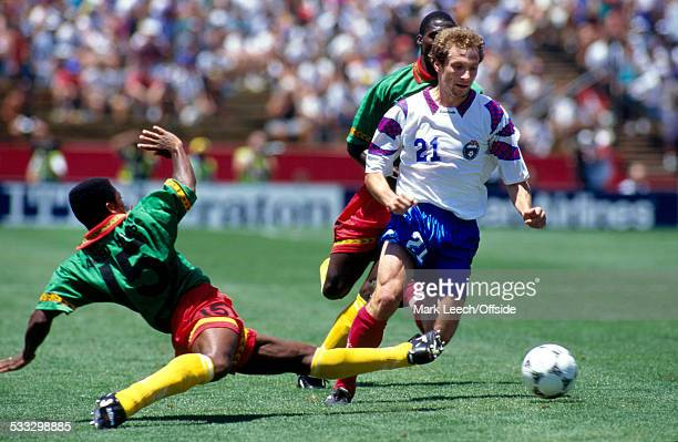28 June 1994 Fifa World Cup Russia v Cameroon Hans Agbo of Cameroon tackles Dmitri Khlestov of Russia