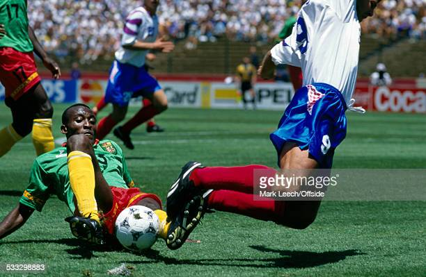 28 June 1994 Fifa World Cup Russia v Cameroon MarcVivien Foe of Cameroon tackles Oleg Salenko of Russia