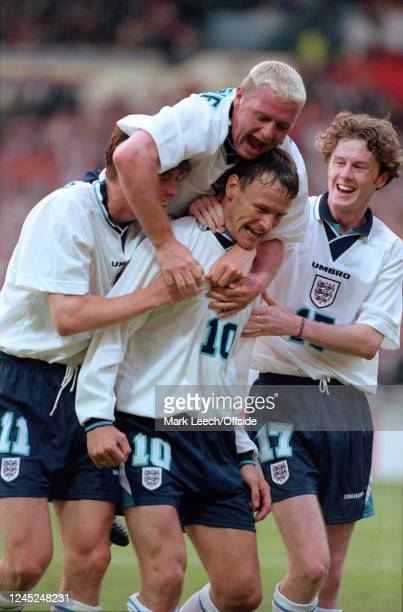 June 1996 - Euro 96 - Group Stage - Netherlands v England - Nick Barmy, Paul Gascoigne, Teddy Sheringham and Steve McManaman of England celebrate...