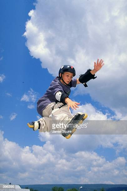 A view of a young boy doing InLine tricks during the Extreme Sports Camp for Kids at Woodward camp Pennsylvania Mandatory Credit Jamie Squire...
