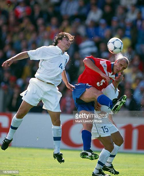 11 June 1998 FIFA World Cup Chile v Italy Water sprays from the head of Chilean defender Javier Margas as he is challenged by Fabio Cannavaro and...