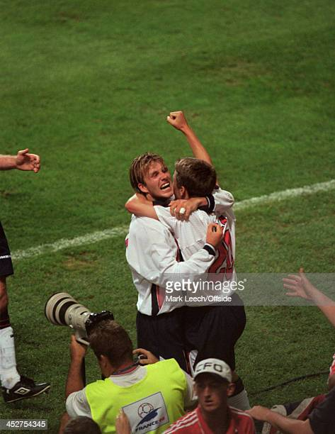June 1998 - FIFA World Cup - England v Romania - David Beckham celebrates with Michael Owen in front of the England fans after Owens goal for England.