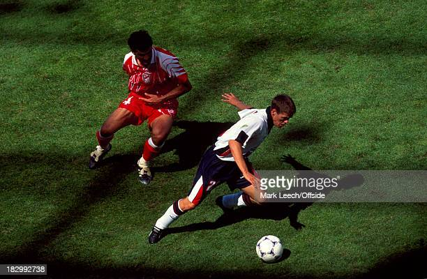 15 June 1998 FIFA World Cup England v Tunisia Michael Owen runs with the ball in the shadows of the main grandstand after coming on as substitute in...