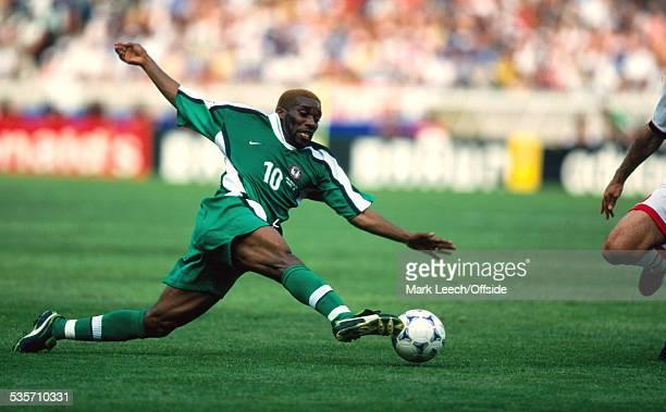 June 1998 FIFA World Cup, Nigeria v Bulgaria, Jay Jay Okocha of Nigeria stretches for the ball.