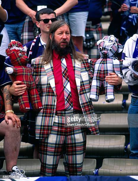 16 June 1998 FIFA World Cup Scotland v Norway a Scottish supporter holds two tartan teddy bears