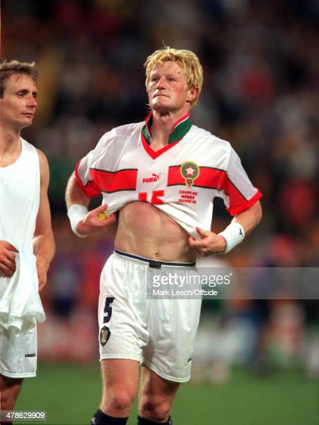 June 1998 - Football World Cup 1998 - Scotland v Morocco - Colin Hendry of Scotland wears a Morocco shirt after swapping at the end of the match.