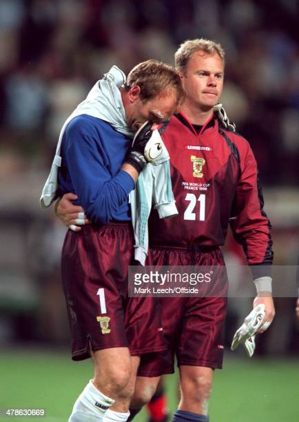 June 1998 - Football World Cup 1998 - Scotland v Morocco - Scotland substitute goalkeeper Jonathan Gould consoles teammate Jim Leighton after losing...