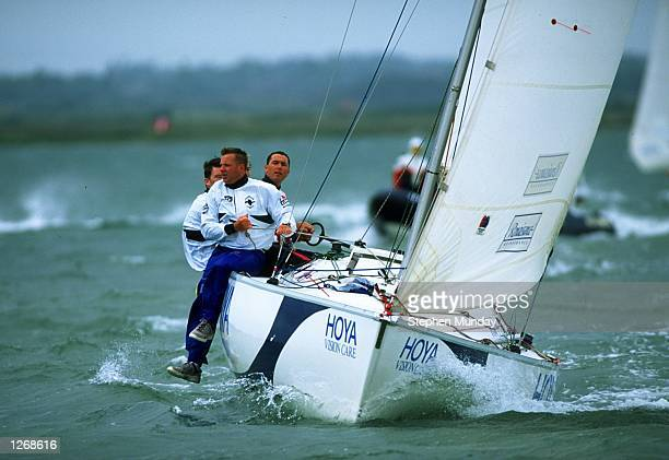Gavin Brady of New Zealand guides his team upwind during the Hoya Royal Lymington Cup Britain's only grade 1 match racing event in the Solent near...
