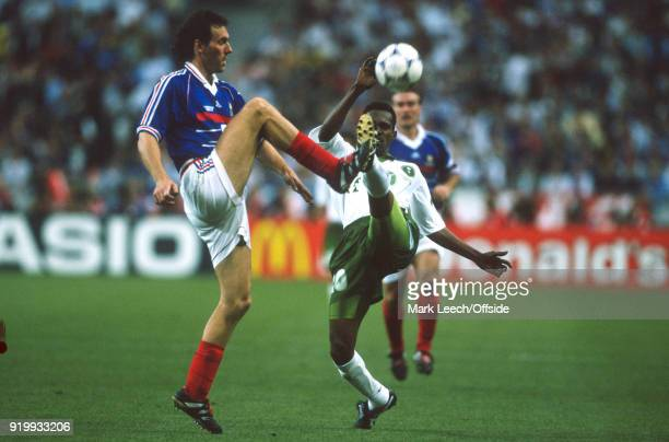 18 June 1998 World Cup 1998 Football France v Saudi Arabia Laurent Blanc of France makes a tackle to win the ball from Hamza Saleh of Saudi Arabia