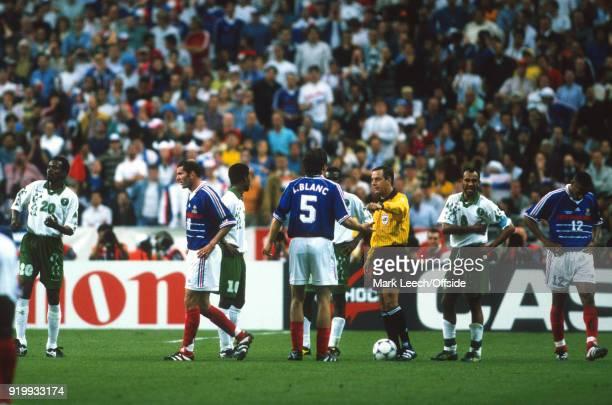 18 June 1998 World Cup 1998 Football France v Saudi Arabia Zinedine Zidane is sent off by referee BRIZIO CARTER Arturo as Laurent Blanc questions the...