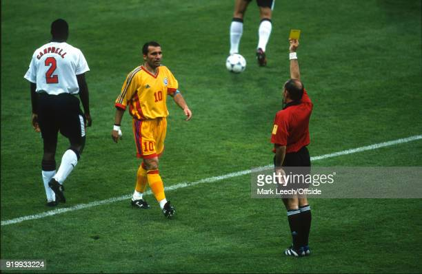 22 June 1998 World Cup 1998 Football Romania v England Gheorghe Hagi of Romania is shown a yellow card by referee Marc Batta