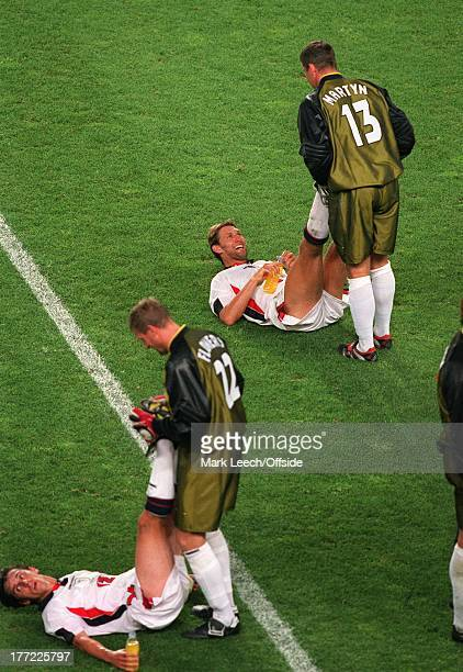 June 1998 World Cup France '98 - Argentina v England, Gary Neville and Tony Adams receive treatment from reserve goalkeepers Flowers and Martyn...
