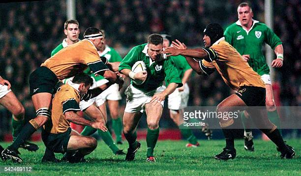 12 June 1999 Kevin Maggs Ireland is tackled by David Giffin left Nathan Spooner and Toutai Kefu right Australia 1999 Australia Tour Lansdowne Cup...