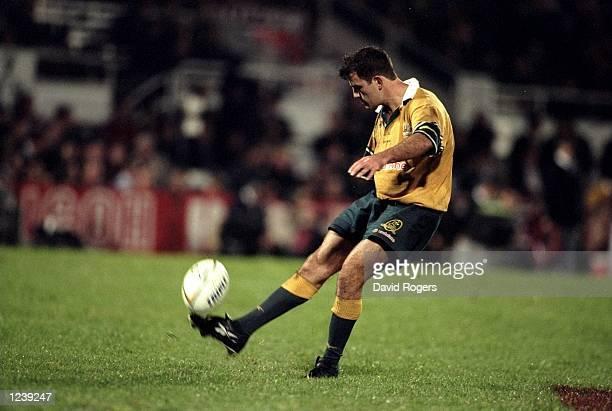 Nathan Spooner of Australia kicks during the first test match between Australia and Ireland played at Ballymore in Brisbane Australia Australia won...